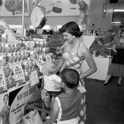 A family shops at a grocery store in El Dorado, AR in 1955